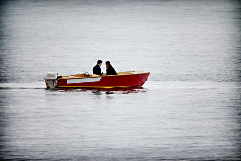 Couple riding in boat
