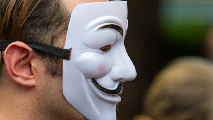person weraing anonymous mask